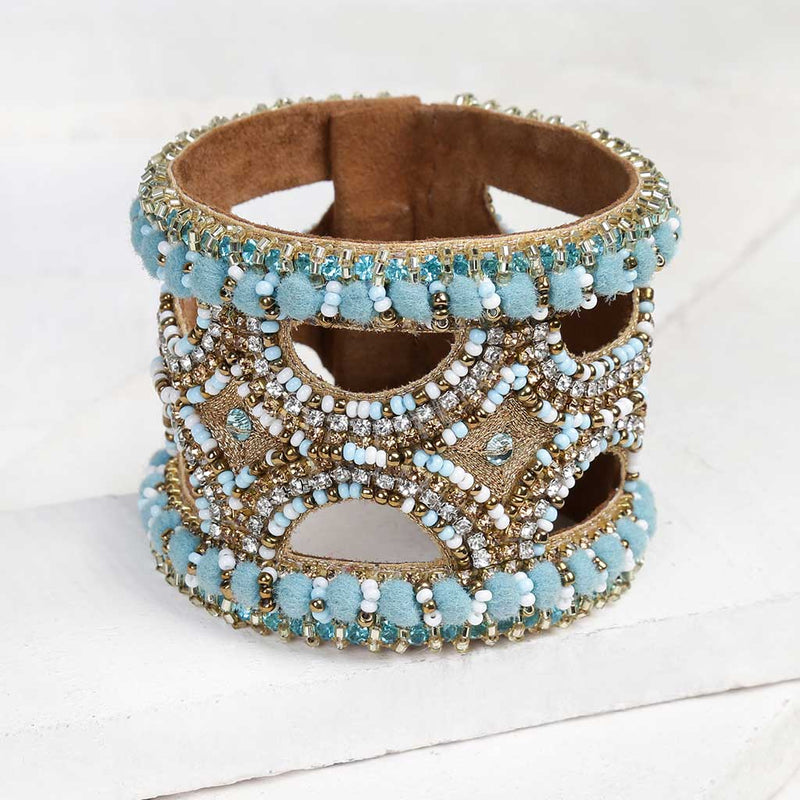 Deepa by Deepa Gurnani Handmade Keiko Cuff in Turquoise on Wood Background