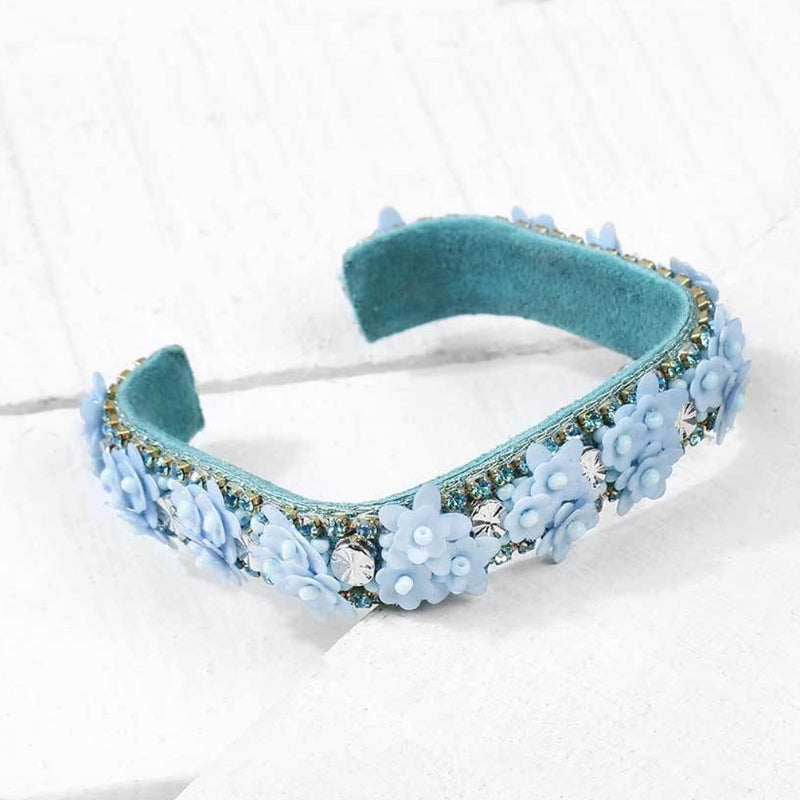 Deepa by Deepa Gurnani Handmade Rosalie Cuff in Sky Blue on Wood Background