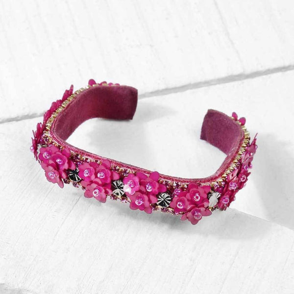 Deepa by Deepa Gurnani Handmade Rosalie Cuff in Magenta on Wood Background