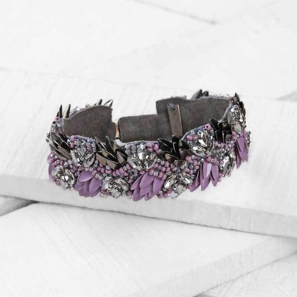 Deepa by Deepa Gurnani Amani Bracelet in Lavender on Wood Background