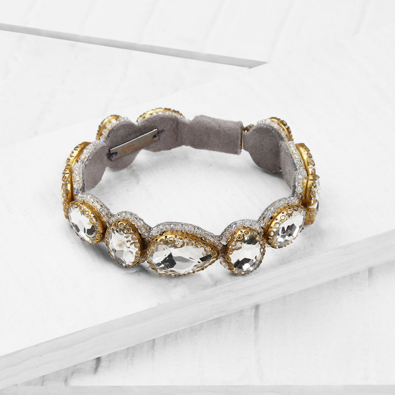 Deepa by Deepa Gurnani Handmade Embroidered Jordyn Bracelet in Silver on Wood Background