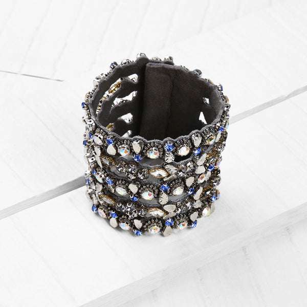 Deepa by Deepa Gurnani Handmade Imani Cuff in Gunmetal on Wood Background