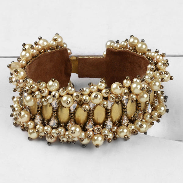Deepa by Deepa Gurnani Handmade Keira Cuff Gold on Wood Background