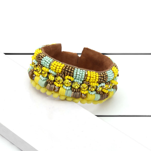 Deepa by Deepa Gurnani Handmade Yasmeen Cuff Yellow on Wood Background