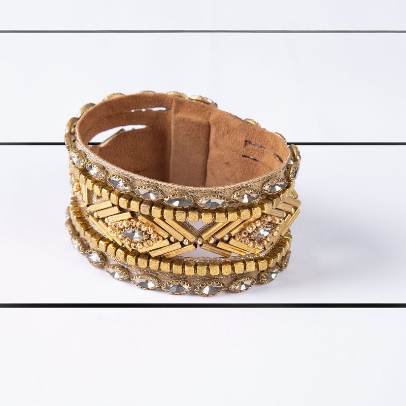Deepa by Deepa Gurnani Handmade Kajal Cuff Gold on Wood Background