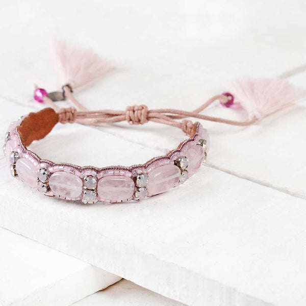 Deepa by Deepa Gurnani Handmade Kip Bracelet in Pink on Wood Background