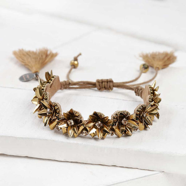 Deepa by Deepa Gurnani Handmade Quincy Bracelet in Gold on Wood Background