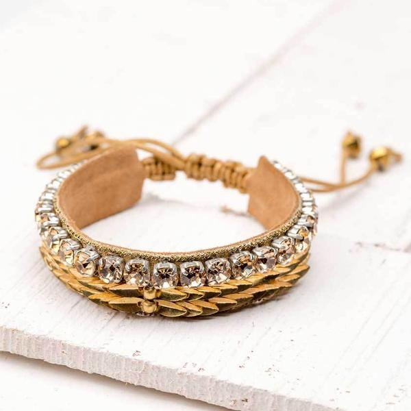 Deepa by Deepa Gurnani Handmade Yoko Bracelet in Gold on Wood Background