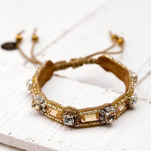 Deepa by Deepa Gurnani Handmade Gillie Bracelet in Gold on Wood Background
