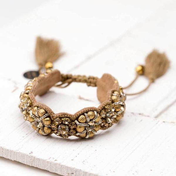 Deepa by Deepa Gurnani Handmade Silvia Bracelet in Gold on Wood Background