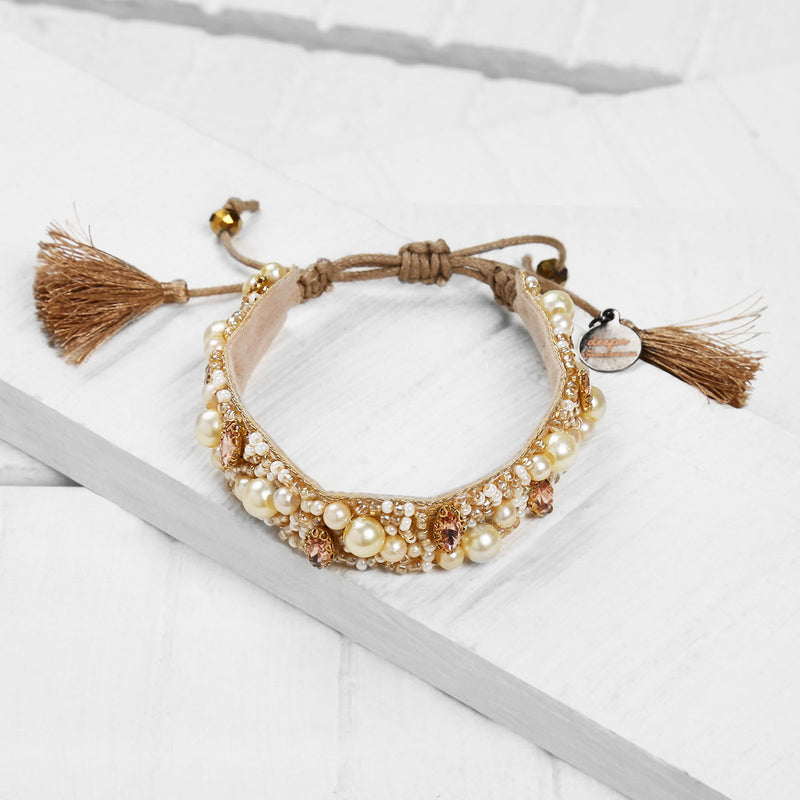 Deepa by Deepa Gurnani Handmade Emery Bracelet on Wood Background