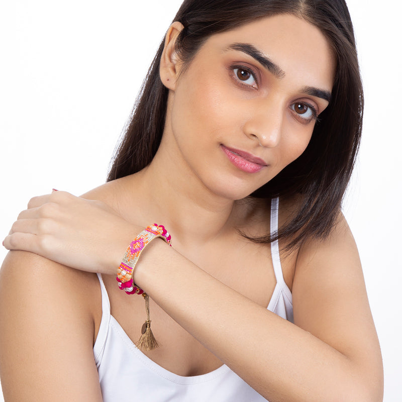 Model Wearing Hand Embroidered Alessia Bracelet in Fuchsia