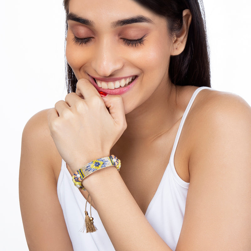 Model Wearing Hand Embroidered Alessia Bracelet in Yellow