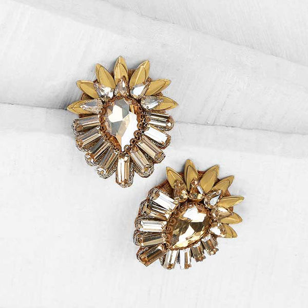 Deepa by Deepa Gurnani Handmade Aryanna Clip-On in Gold on Wood Background