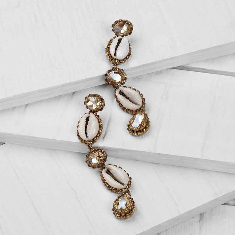 Deepa by Deepa Gurnani Handmade Kaia Shell Earrings in Gold on Wood Background
