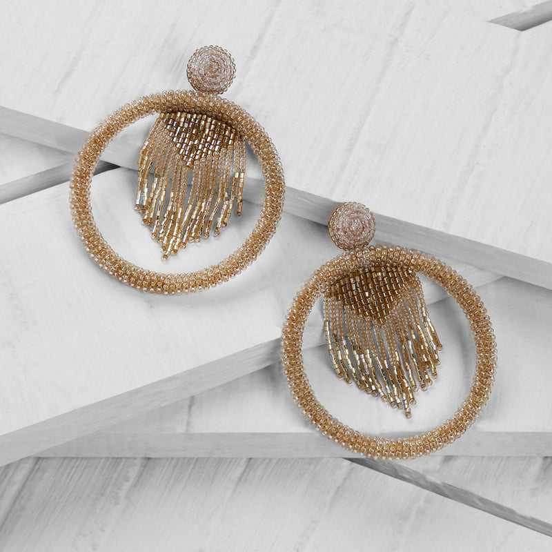 Deepa by Deepa Gurnani Handmade Sadia Earrings in Gold on Wood Background