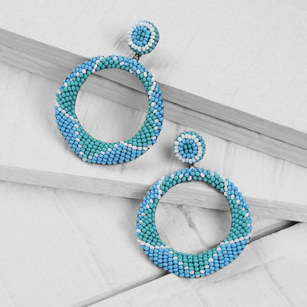 Deepa by Deepa Gurnani Handmade Embroidered Leila Earrings in Blue on Wood Background