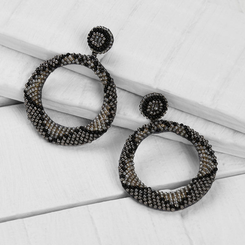 Deepa by Deepa Gurnani Handmade Embroidered Leila Earrings in Black on Wood Background