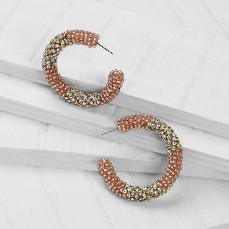 Deepa by Deepa Gurnani Handmade Lana Hoop Earrings Rose Gold on Wood Background