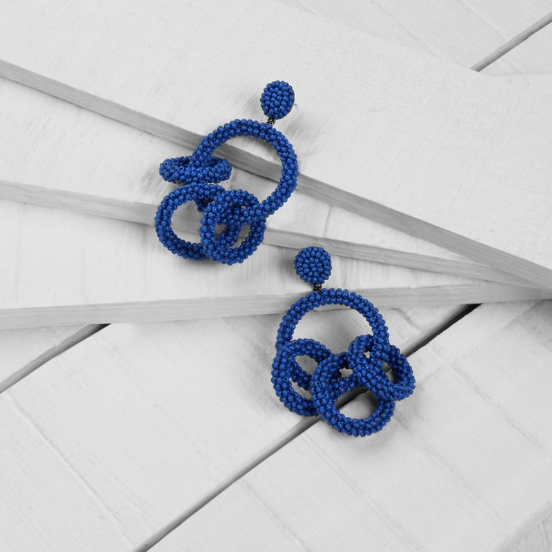 Deepa by Deepa Gurnani Handmade Karlee Earrings in Cobalt on Wood Background