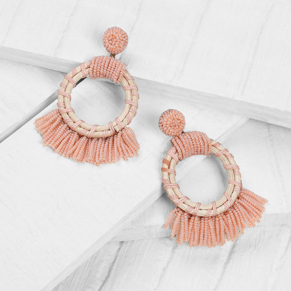 Deepa by Deepa Gurnani Handmade Dabria Earrings in Peach on Wood Background