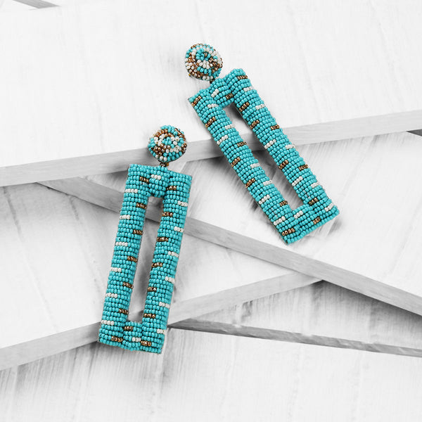 Deepa by Deepa Gurnani Handmade Mera Earrings in Mint on Wood Background