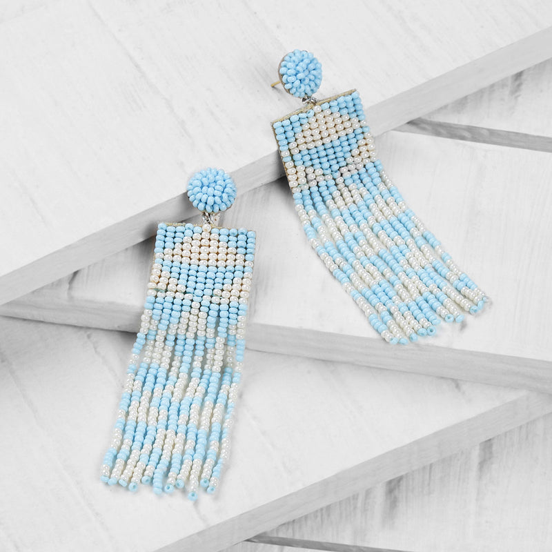 Deepa by Deepa Gurnani Handmade Embroidered Lexia Earrings in Sky Blue on Wood Background