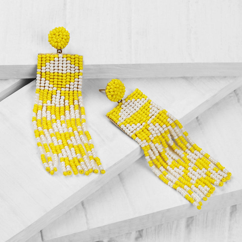 Deepa by Deepa Gurnani Handmade Embroidered Lexia Earrings in Yellow on Wood Background
