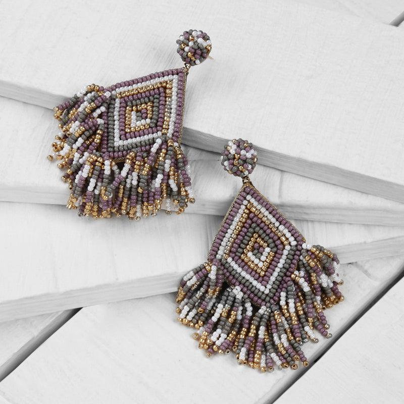 Deepa by Deepa Gurnani Handmade Dottie Earrings in Lavender on Wood Background