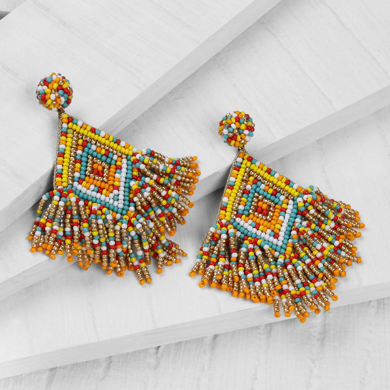 Deepa by Deepa Gurnani Handmade Dottie Earrings in Yellow on Wood Background