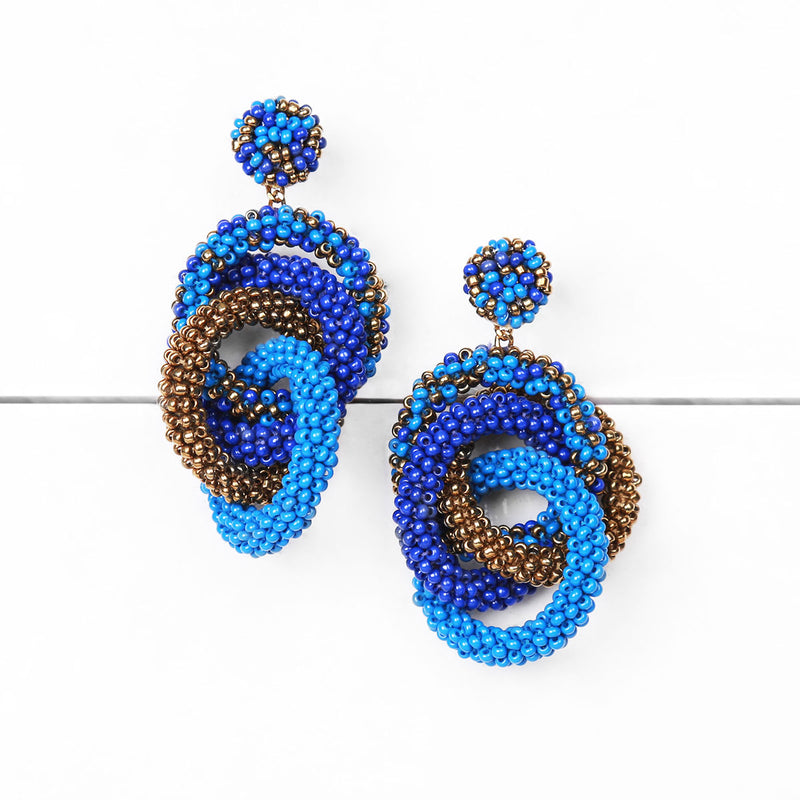 Deepa by Deepa Gurnani Carolyn Earrings Blue on Wood Background