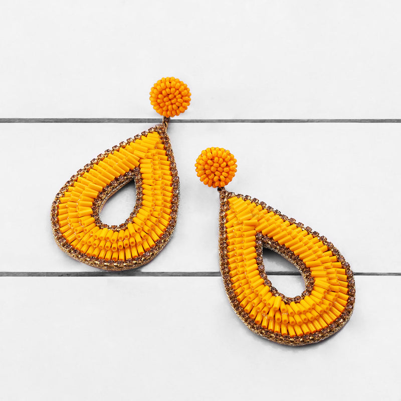 Deepa by Deepa Gurnani Abia Tear Drop Earrings Orange on Wood Background