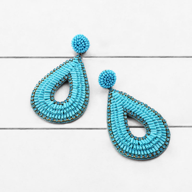 Deepa by Deepa Gurnani Abia Tear Drop Earrings Turquoise on Wood Background
