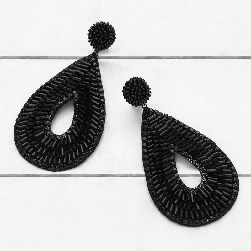 Deepa by Deepa Gurnani Abia Tear Drop Earrings Black on Wood Background