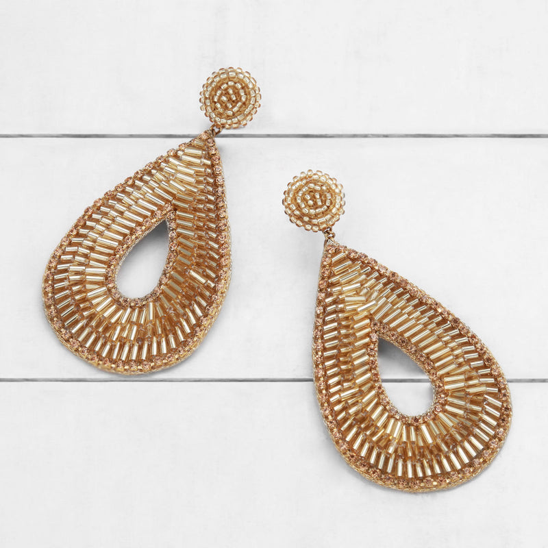Deepa by Deepa Gurnani Abia Tear Drop Earrings Gold on Wood Background