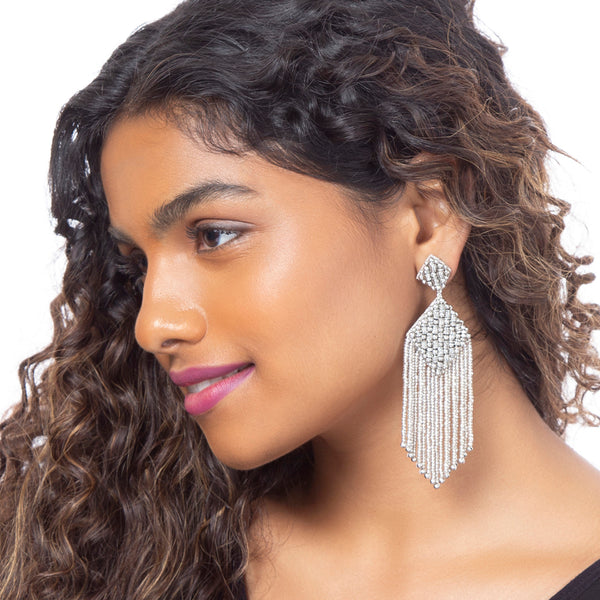 model wearing handmade beaded silver earrings