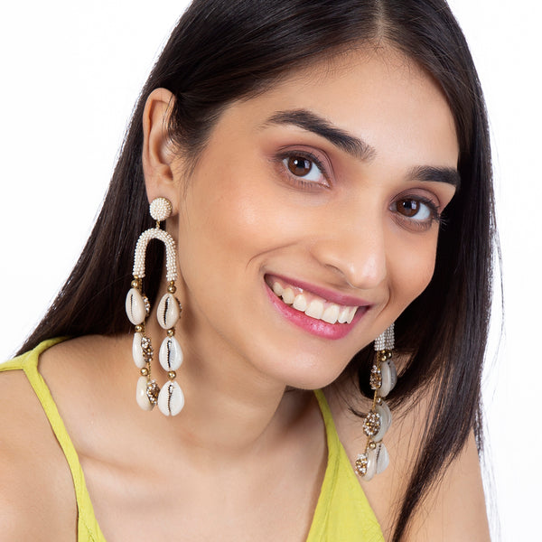model wearing handmade beaded shell earrings
