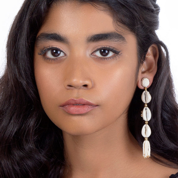 Model wearing Shell earrings with beaded tassel