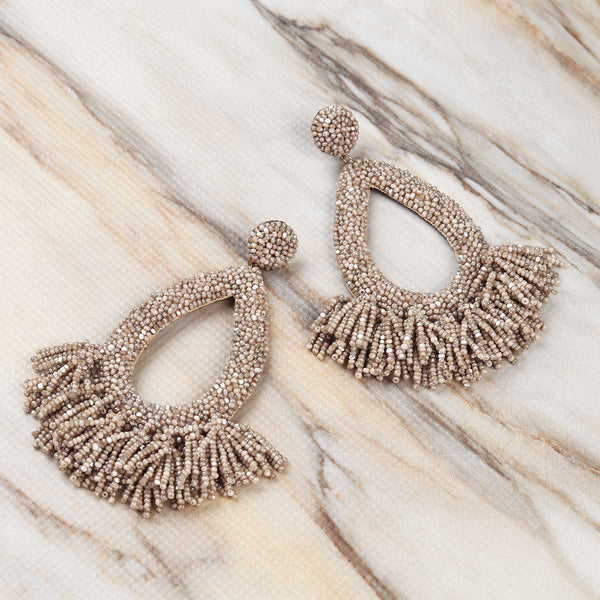 Deepa Gurnani Handmade Rafela Earrings in Champagne on Marble Background
