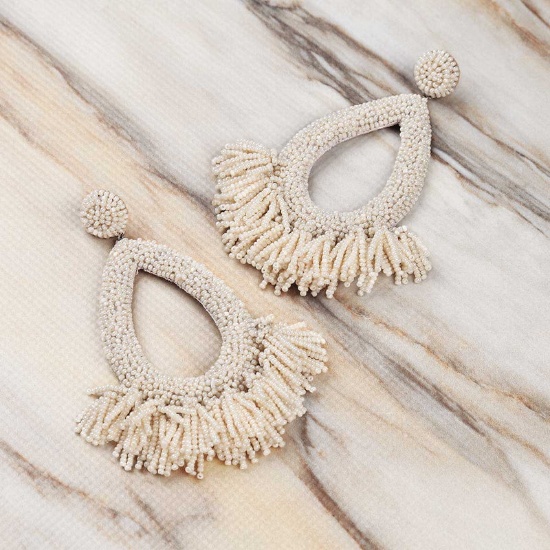 Deepa Gurnani Handmade Rafela Earrings in Ivory on Marble Background