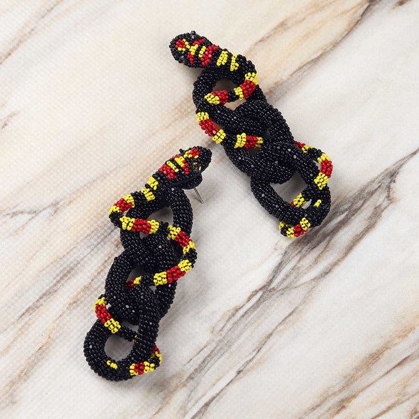 Deepa Gurnani Handmade Haze Earrings in Black on Marble Background