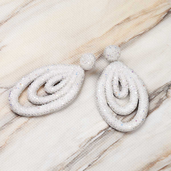 Deepa Gurnani Embroidered Handmade Winifred Earrings in White on Marble Backgroumd