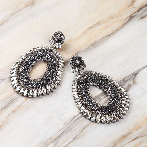 Deepa Gurnani Handmade Kiki Earrings in Gunmetal on Marble Background