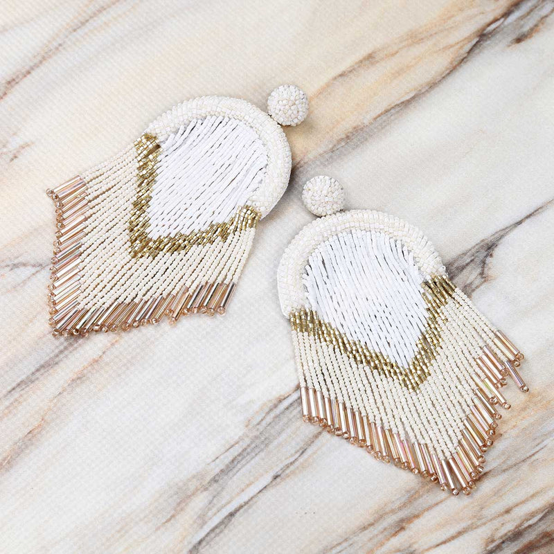 Deepa Gurnani Handmade Hasfa Earrings in Ivory on Marble Background