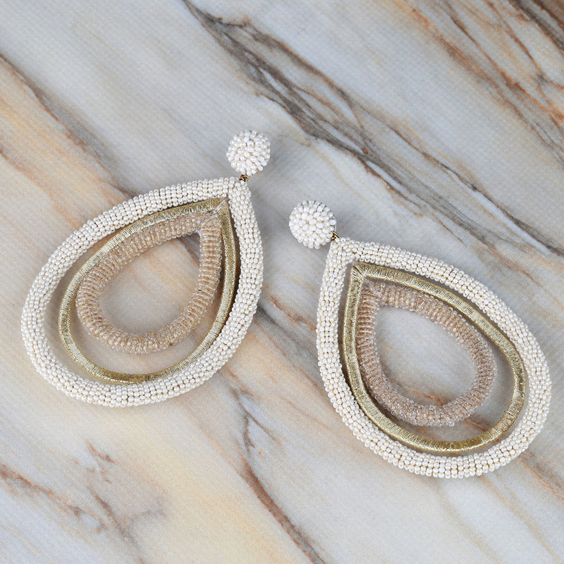 Handmade embroidered multi teardrop statement earrings on Marble Background