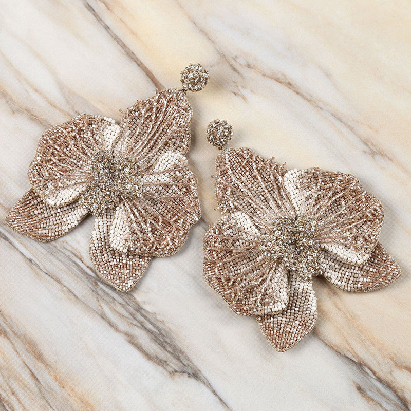 Deepa Gurnani Lightweight Orchid Statement Earrings Light Gold on Marble Background