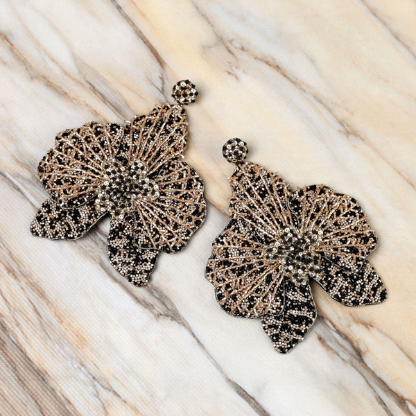 Deepa Gurnani Lightweight Orchid Statement Earrings Black on Marble Background