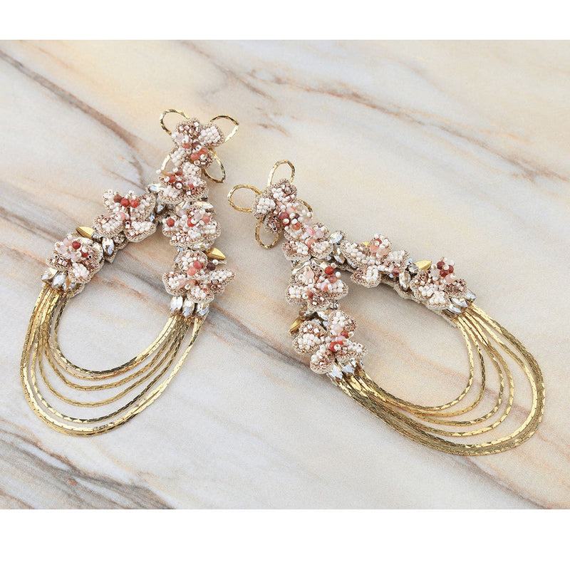 Deepa Gurnani Handmade Kassidy Earrings Gold on Marble Background
