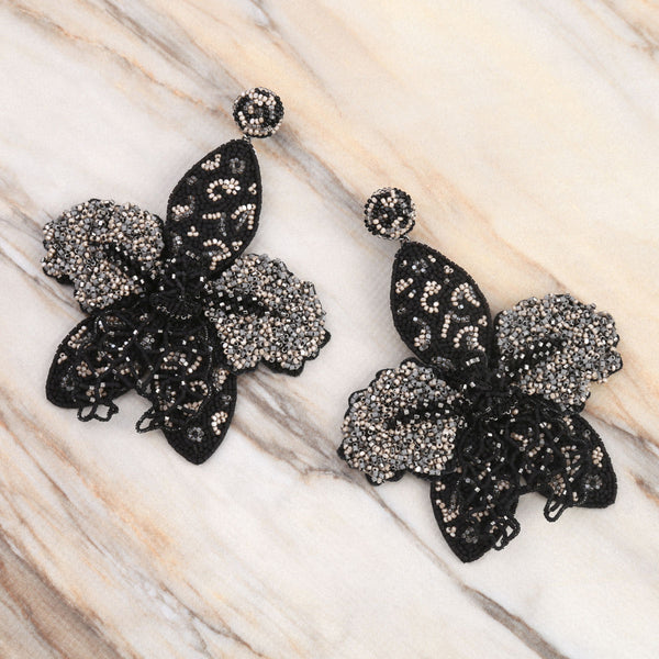 Deepa Gurnani Handmade Desse Earrings on Marble Background