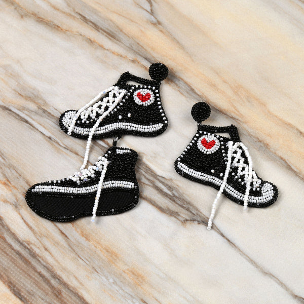 Deepa Gurnani Handmade Sneaker Earrings on Marble Background